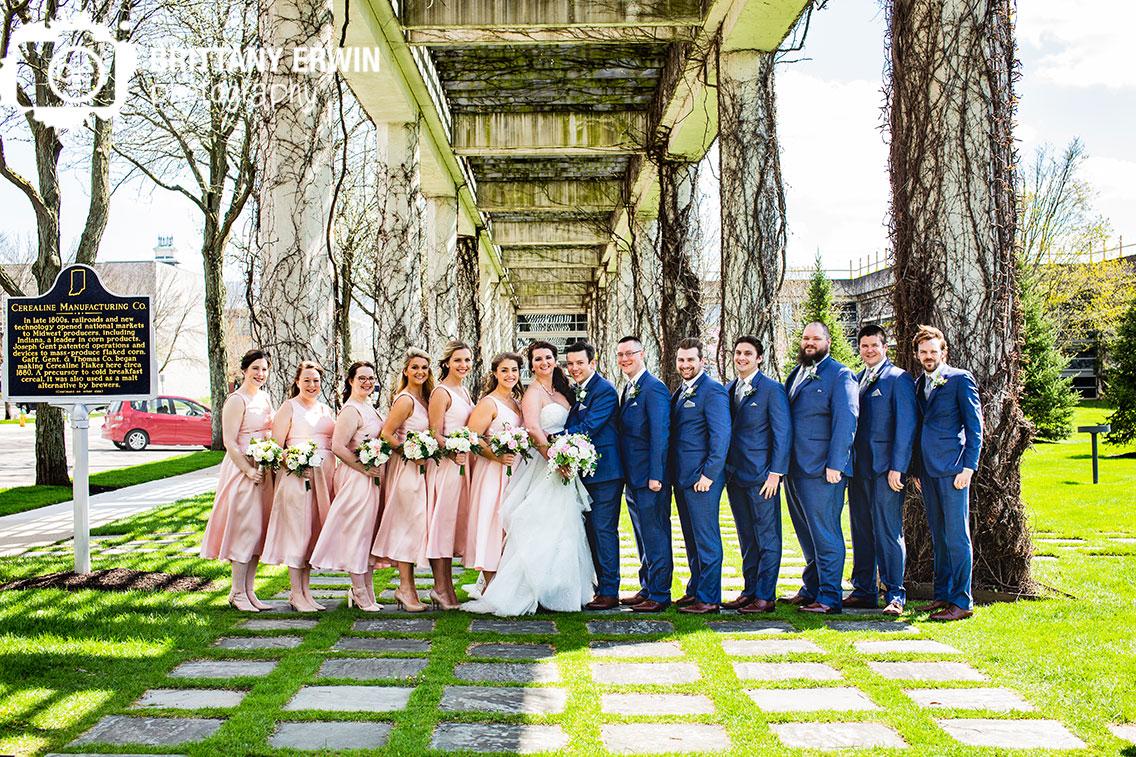 Outdoor-Columbus-Indiana-wedding-photographer-bridal-party-under-cummins-vine-covered.jpg