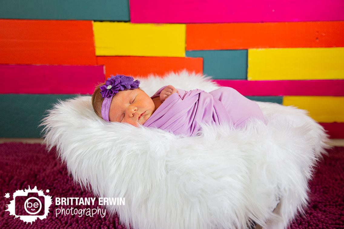 Indianapolis-newborn-baby-girl-portrait-photographer-pallet-wall-purple-wrap-matching-headband.jpg
