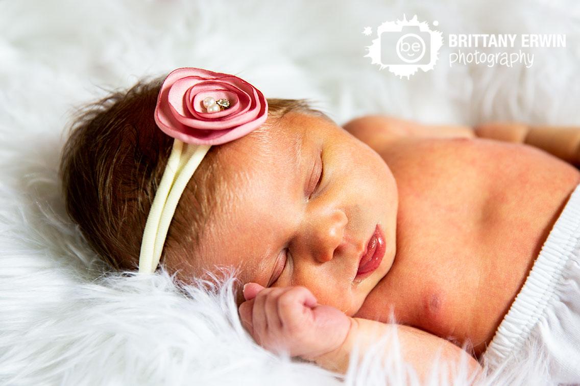 Lifestyle-newborn-portrait-photographer-fuzzy-rug-baby-girl-headband.jpg