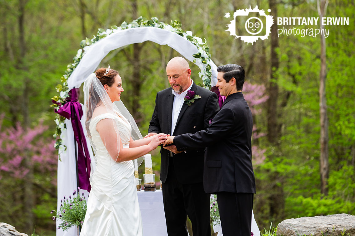 Castle-Indiana-wedding-ceremony-outdoor-arch-exchange-rings.jpg