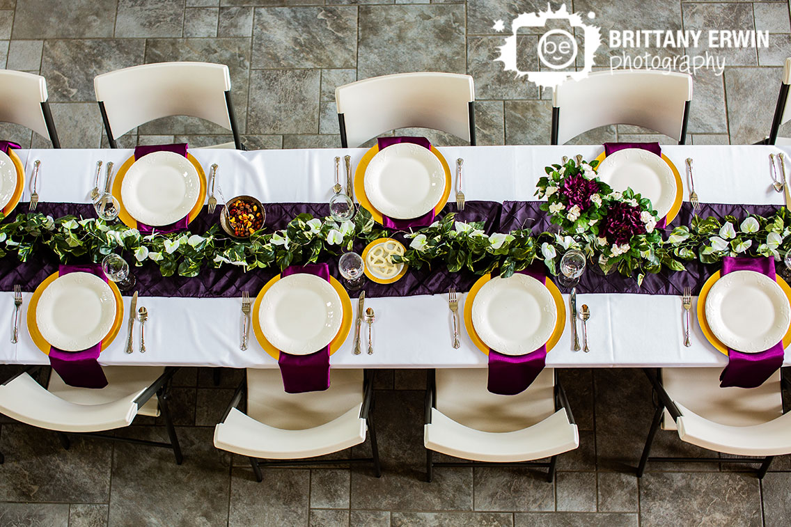 Clayshire-Castle-wedding-photographer-long-banquet-table-purple-runner-charger-napkin-place-setting.jpg