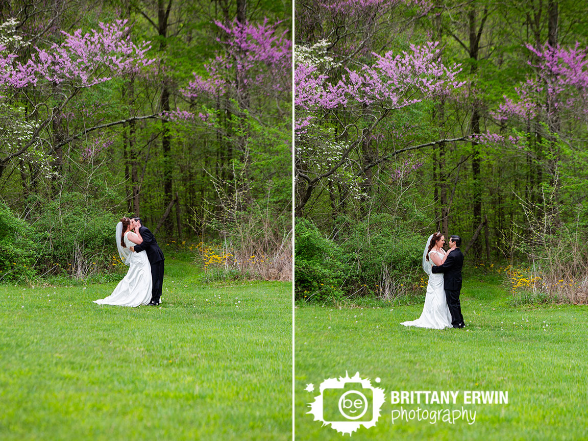 Clayshire-Castle-wedding-photographer-outdoor-spring-portraits-path-between-blooming-redbud-trees.jpg
