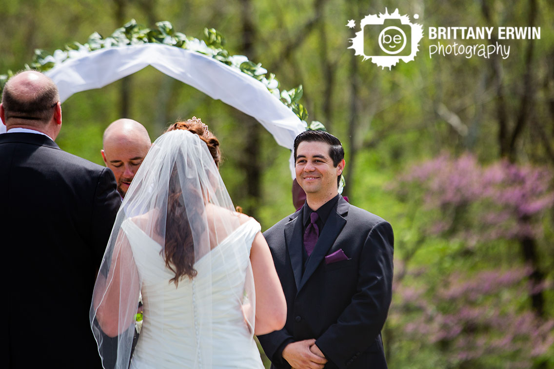 Outdoor-wedding-ceremony-photographer-groom-reaction-as-bride-walks-down-aisle.jpg