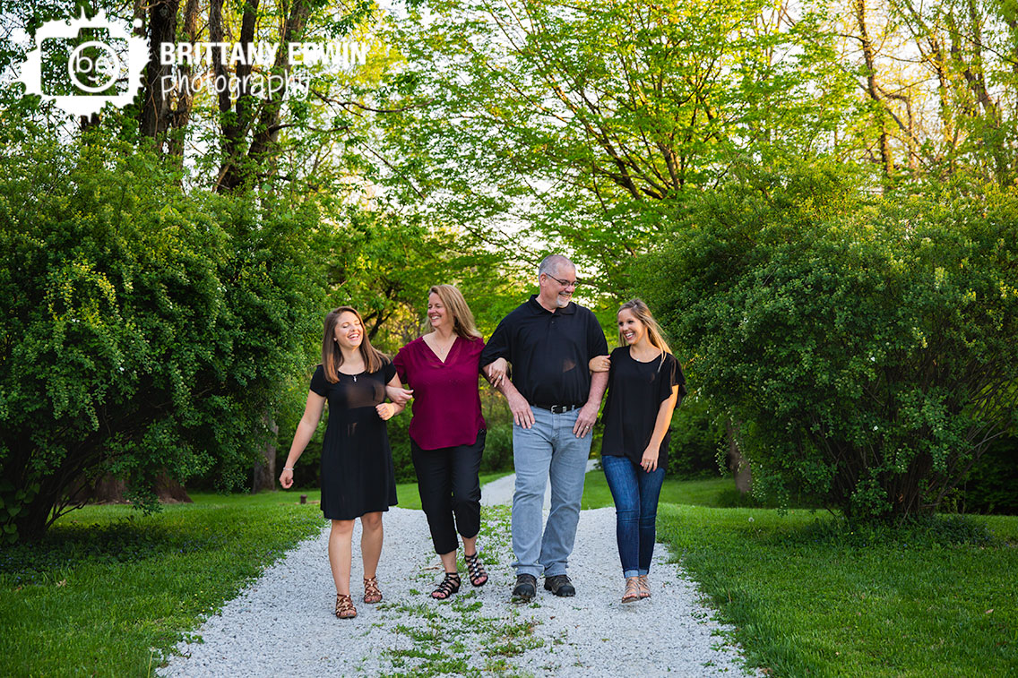 Indianapolis-family-portrait-photographer-group-walking-outside-spring-daughters.jpg