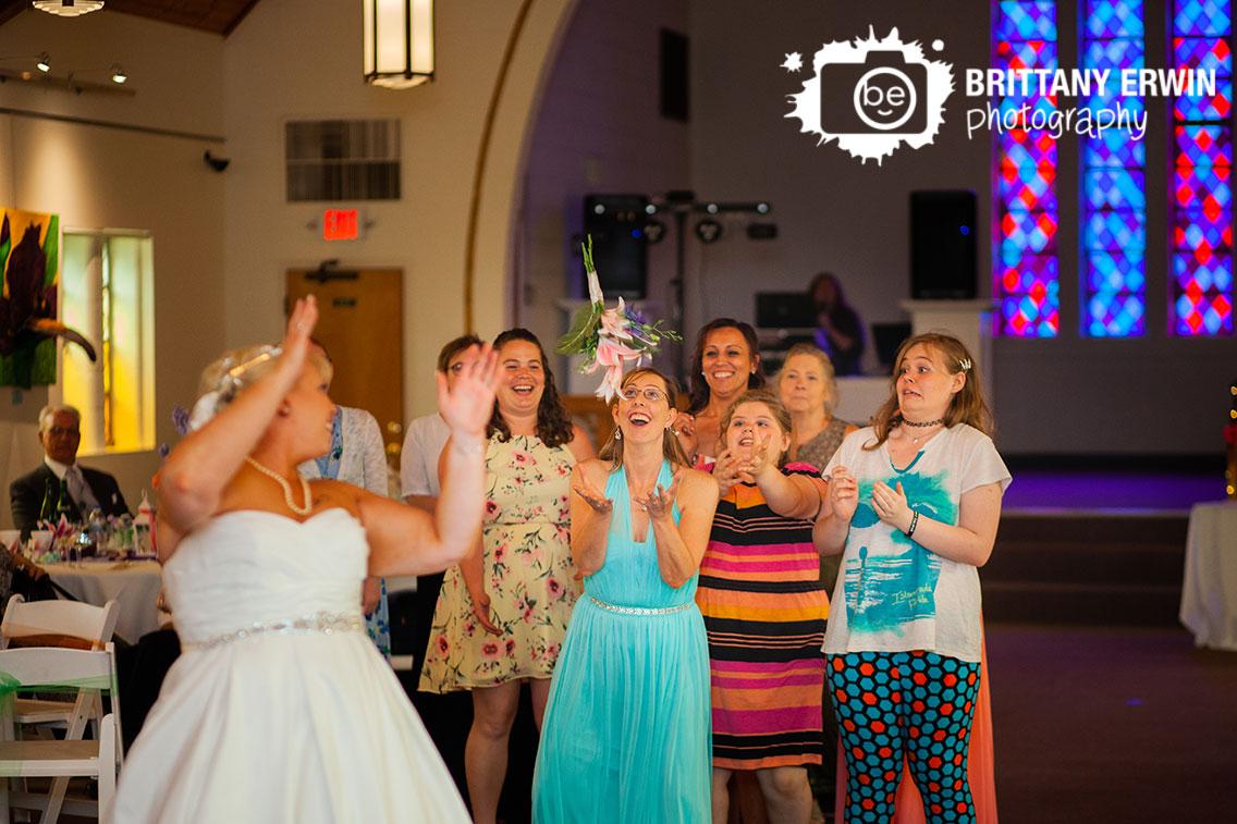 Reception-wedding-photographer-bouquet-toss-art-sanctuary-of-Indiana.jpg