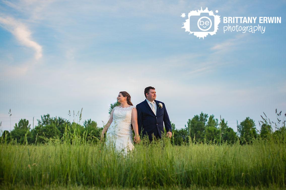 Moorseville-Indiana-wedding-photographer-sunset-skyline-couple-in-tall-grass-field.jpg