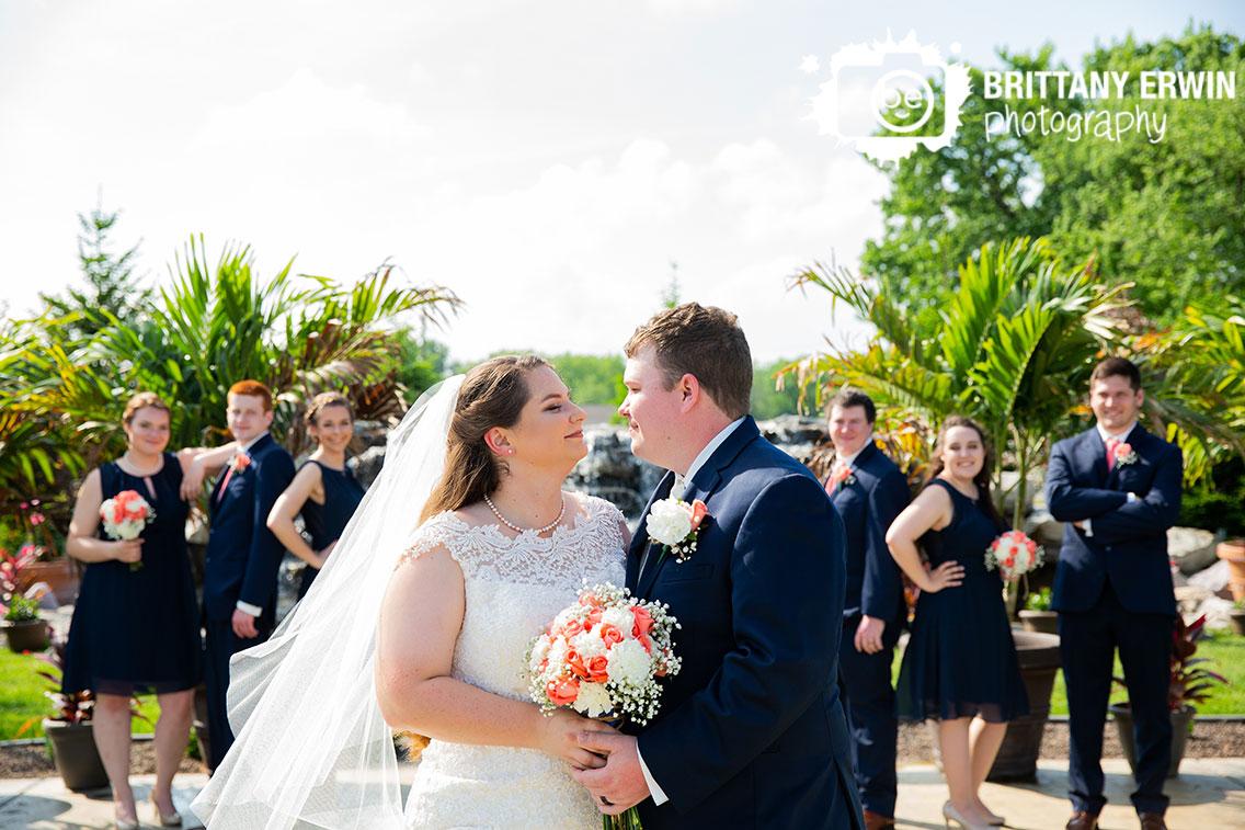 Outdoor-bridal-party-portrait-couple-navy-coral-dress-bouquet.jpg