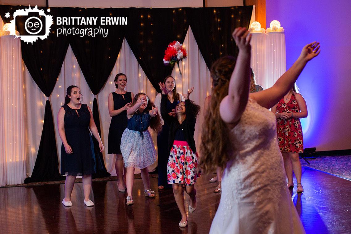 Bouquet-toss-little-girl-catch-reaction-bride.jpg