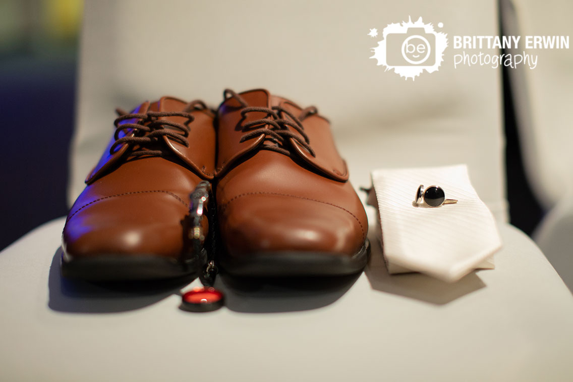 Groom-shoes-tie-cufflinks-bracelet-detail-on-white-chair.jpg
