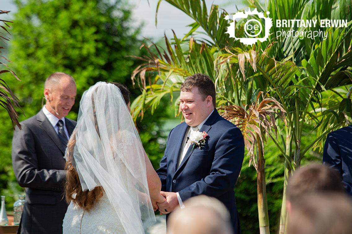 Jones-Crossing-wedding-ceremony-groom-reaction-at-altar-vows.jpg