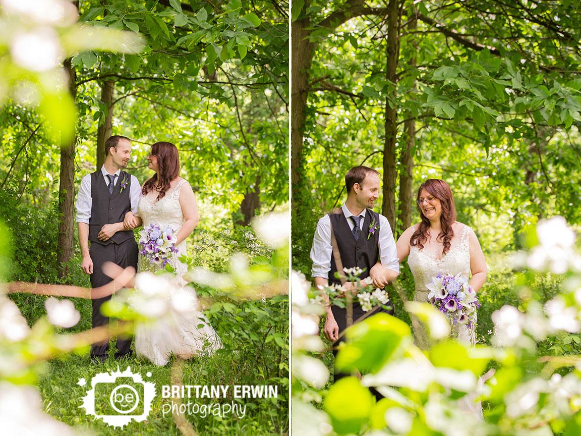 Bride-groom-couple-walk-down-path-outdoor-elopement-purple-bouquet.jpg