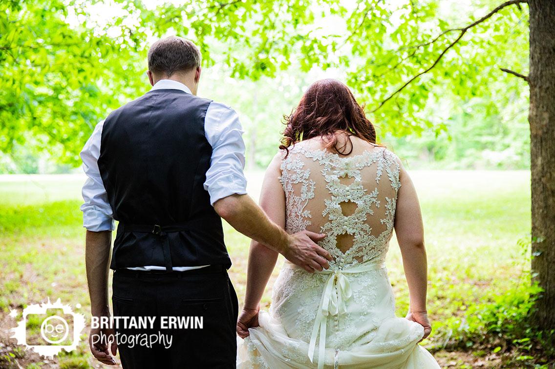 Bride-groom-walk-from-ceremony-site-outdoor-backyard-elopement.jpg
