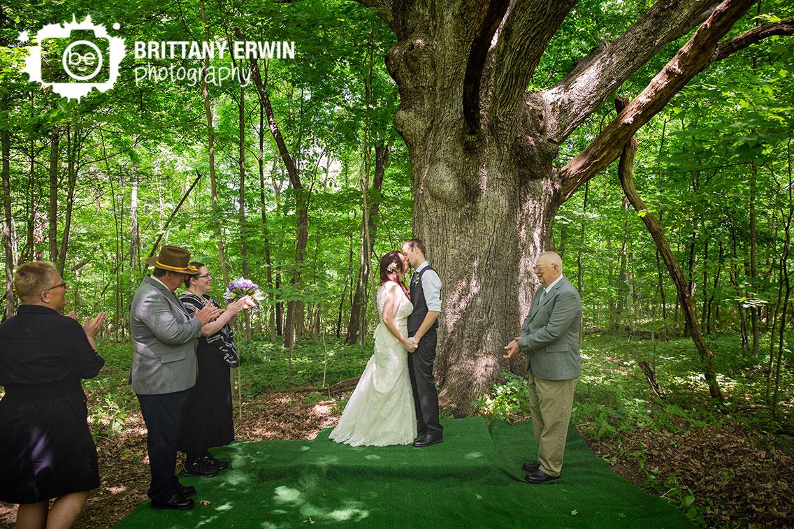 First-Kiss-under-old-oak-tree-ceremony-backyard.jpg