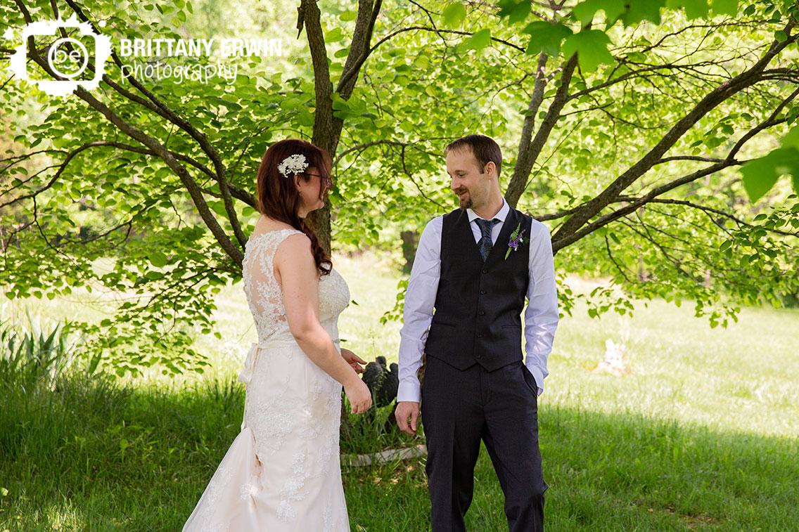 first-look-outdoor-at-home-elopement-backyard.jpg