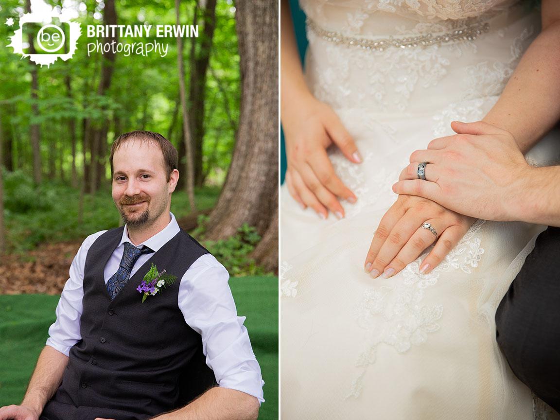 Indiana-elopement-photographer-groom-paisley-tie-rings-hands.jpg