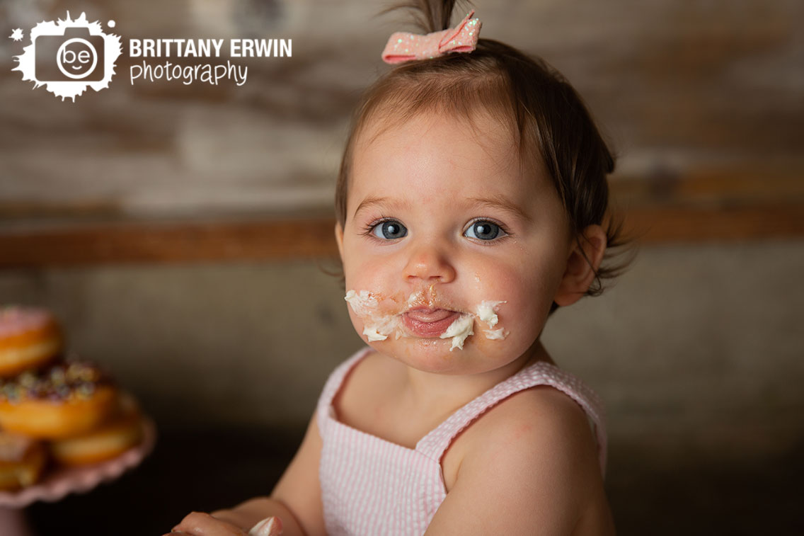 Messy-baby-first-birthday-icing-face-photographer.jpg