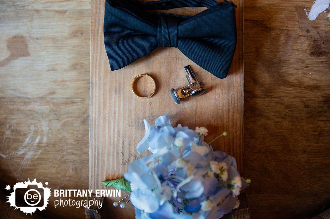 black-bowtie-gold-ring-cufflinks-boutonniere.jpg