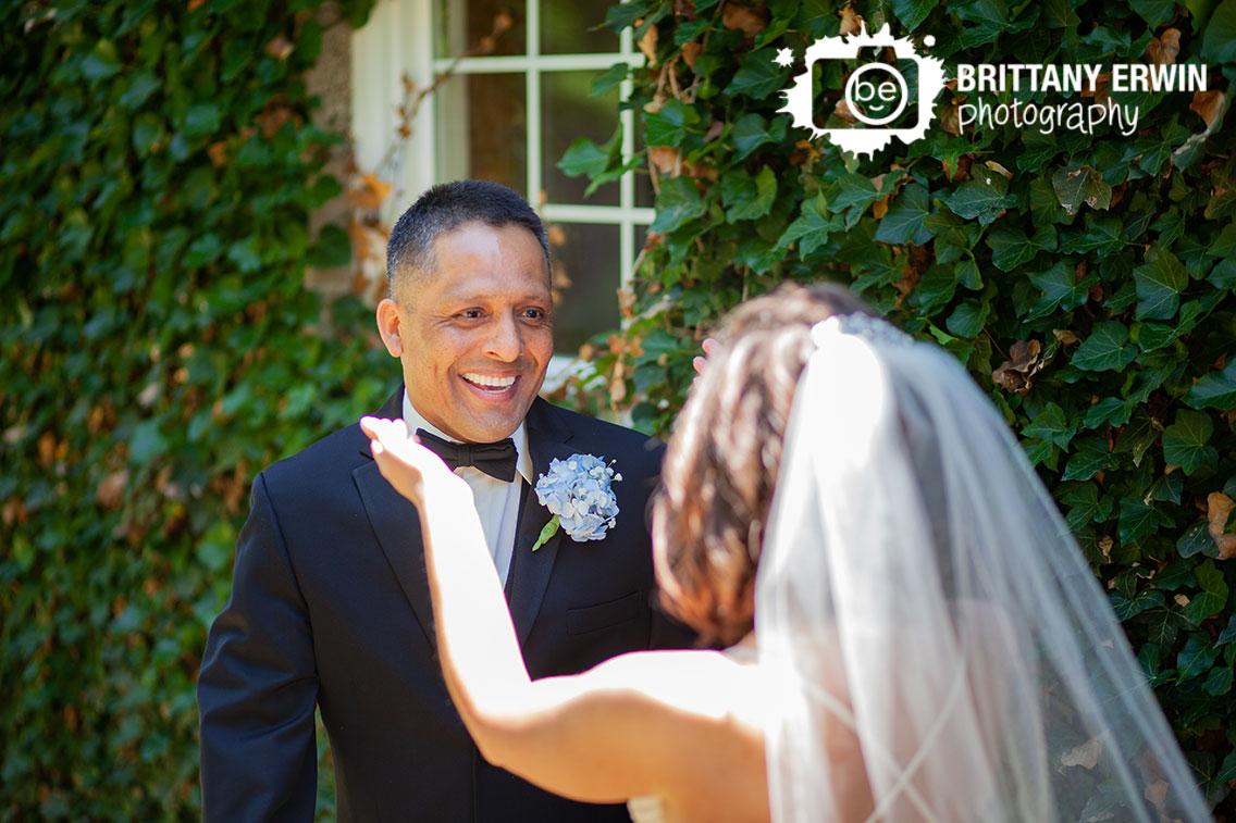 First-look-groom-reaction-teary-smile.jpg