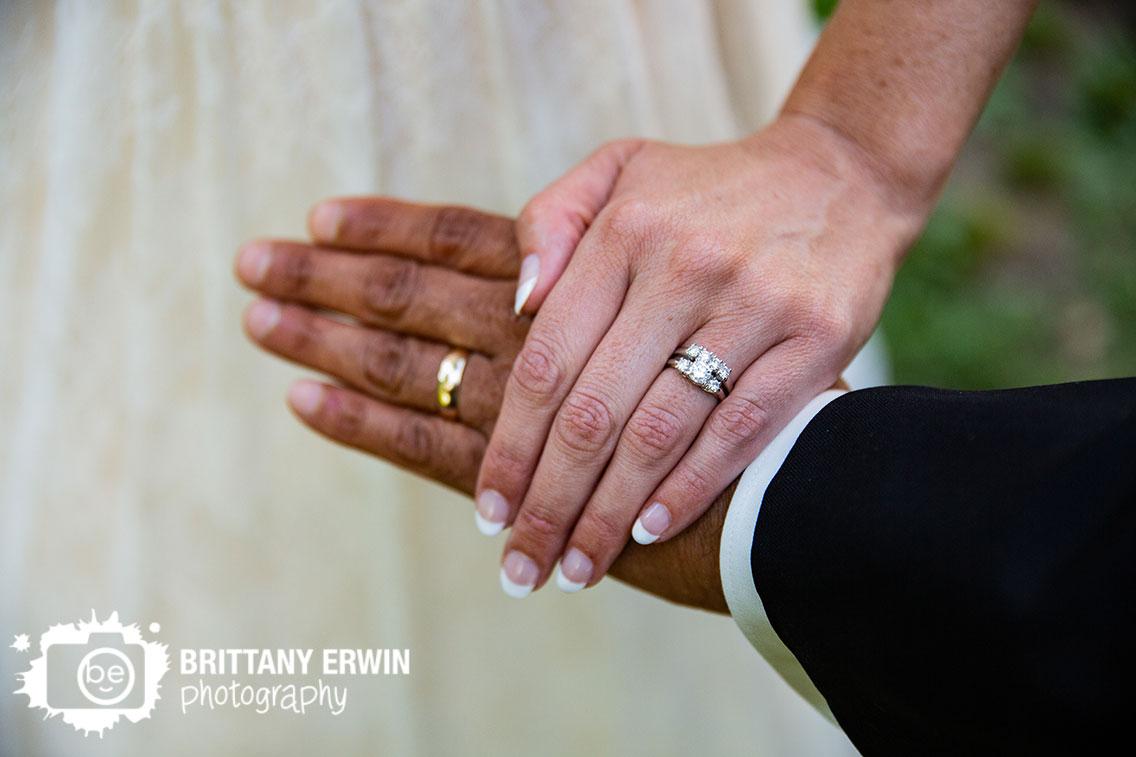 Indiana-wedding-photographer-bride-groom-hands-with-rings.jpg