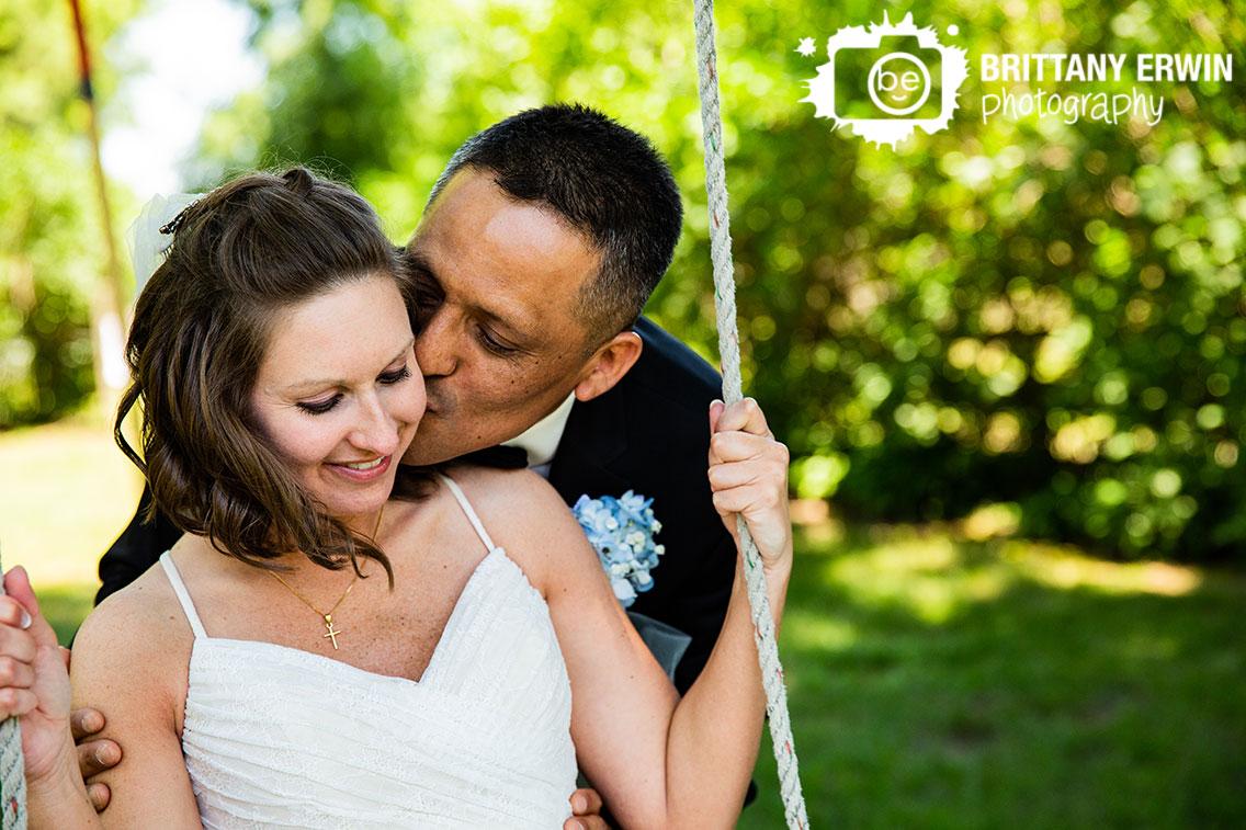 Indiana-wedding-photographer-couple-swing-cheek-kiss.jpg