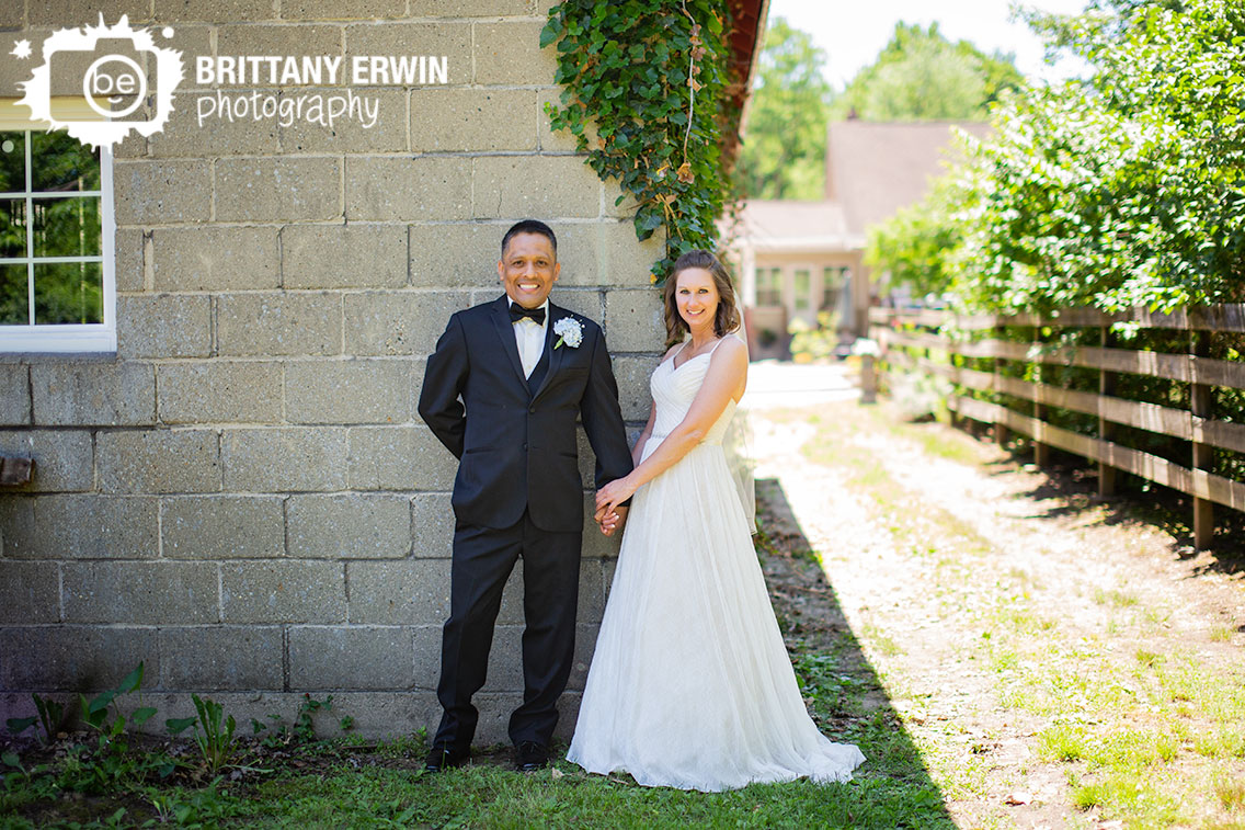 Terre-Haute-watertower-estates-winery-wedding-photographer-couple-ivy-stone-wall.jpg