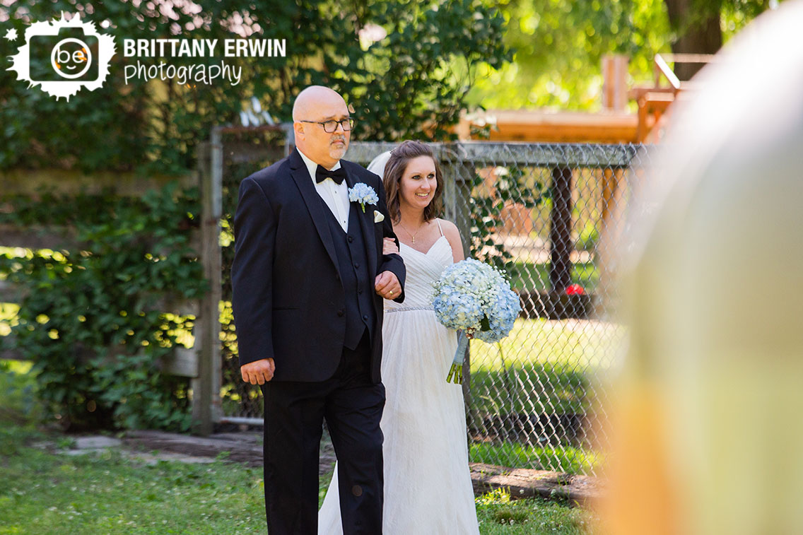 Wedding-photographer-ceremony-bride-walk-down-aisle-with-father.jpg