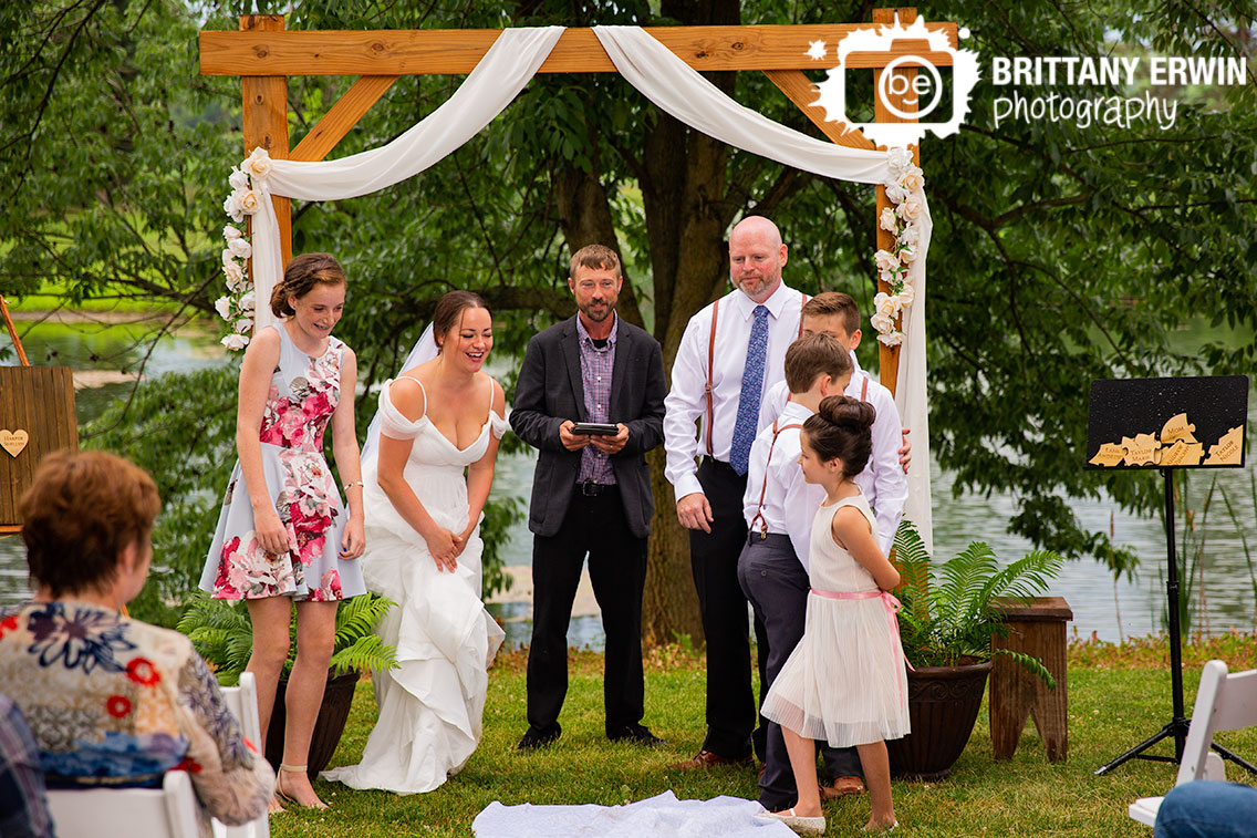 Bride-laughing-outdoor-wedding-ceremony-daughter-at-altar.jpg