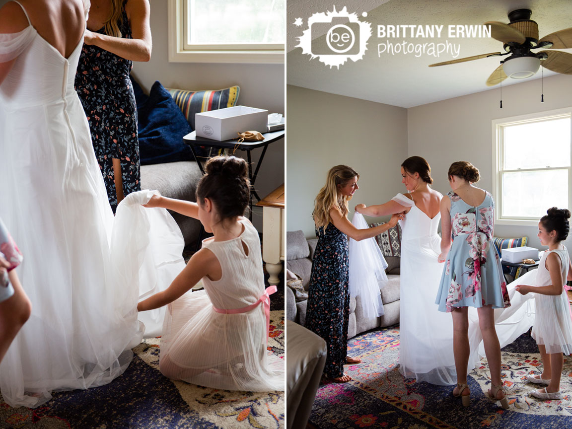 Wedding-photographer-daughter-of-bride-playing-with-dress.jpg