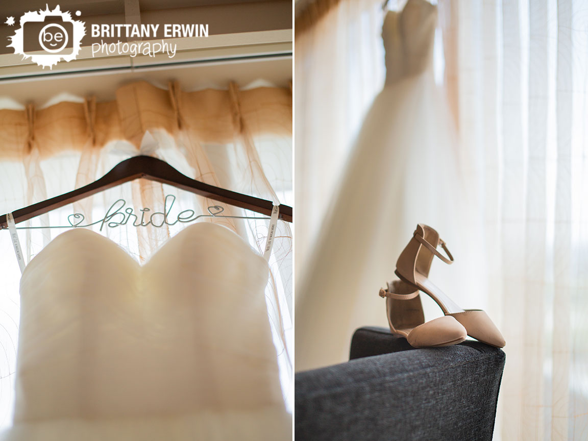 Bridal-gown-bride-wire-custom-hanger-hearts-shoes-detail-in-window.jpg