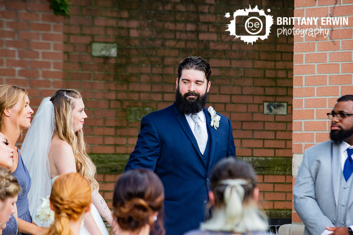 Groom-reaction-to-bride-on-altar-outdoor-summer-photographer.jpg