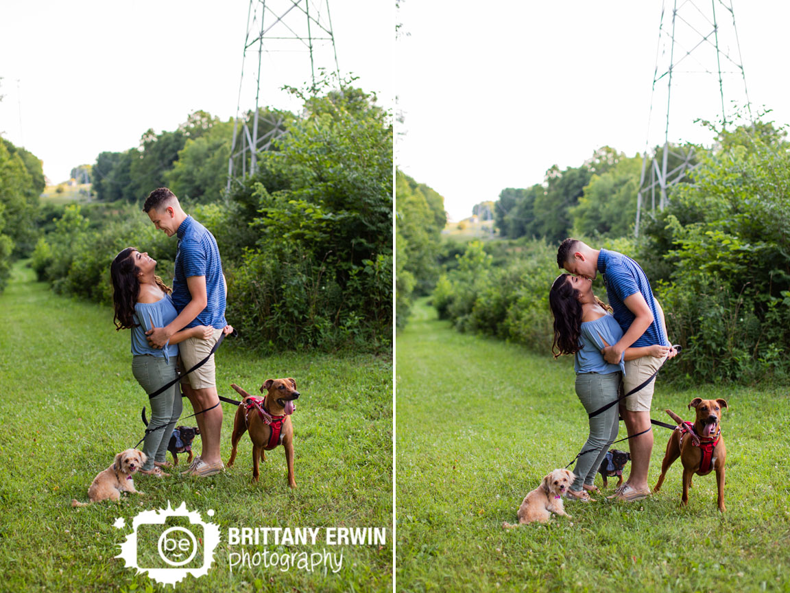 Indianapolis-101-dalmatians-dogs-engagement-portrait-photographer-couple-wrapped-in-leashes.jpg