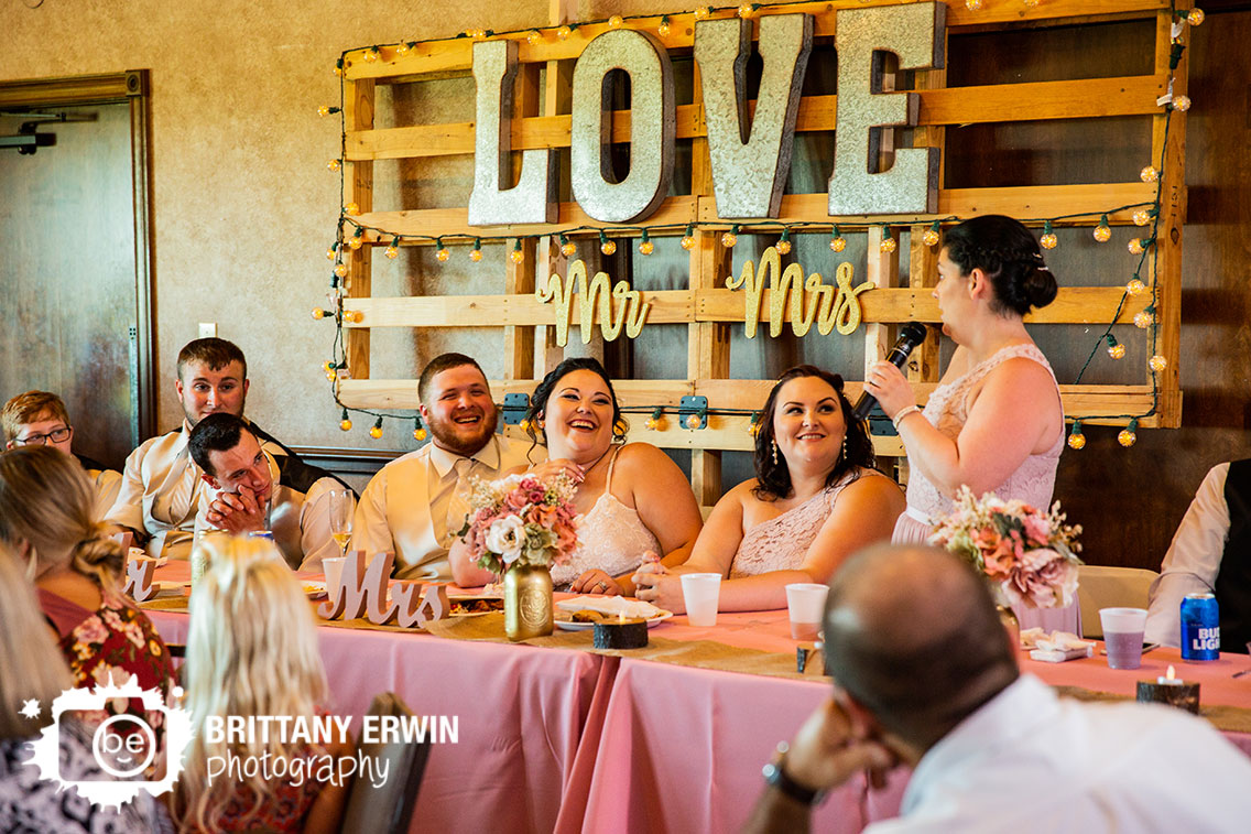 mr-mrs-sign-wedding-reception-toast-bride-laughing.jpg