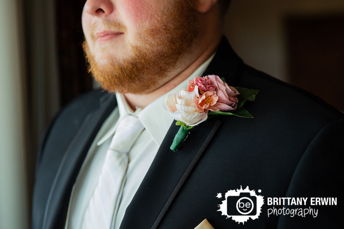 Wedding-photographer-groom-with-boutonniere-detail-portrait.jpg