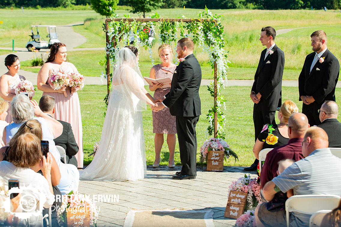 Wedding-ceremony-golf-course-arbor-flower-covered.jpg