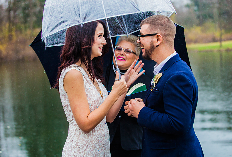 Indianapolis-elopement-photographer-private-dock-on-pond-marry-me-in-indy-ceremony-rain-umbrella.jpg