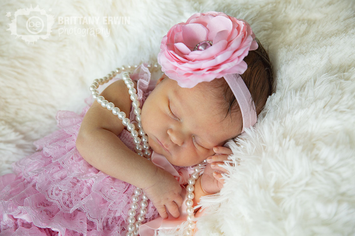 Indianapolis-lifestyle-portrait-photographer-newborn-baby-girl-flower-headband-pink-romper.jpg