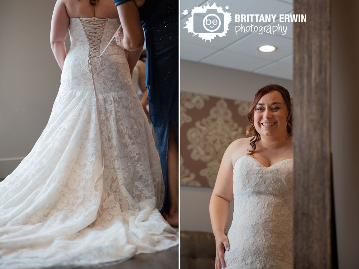 Wedding-photographer-lace-bridal-gown-bride-reaction-looking-in-mirror.jpg