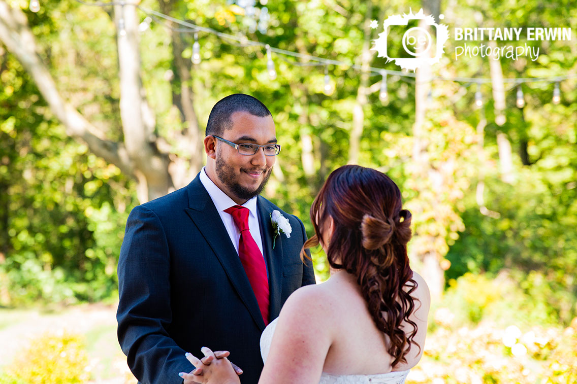 Sycamore-at-Mallow-Run-groom-reaction-wedding-photographer-first-look-outdoor-fall-wedding-red-tie-white-flower-boutonniere.jpg