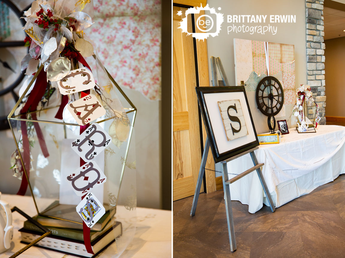 Alice-in-Wonderland-themed-wedding-entry-table-card-bird-cage-glass-playing-cards-custom-clock.jpg