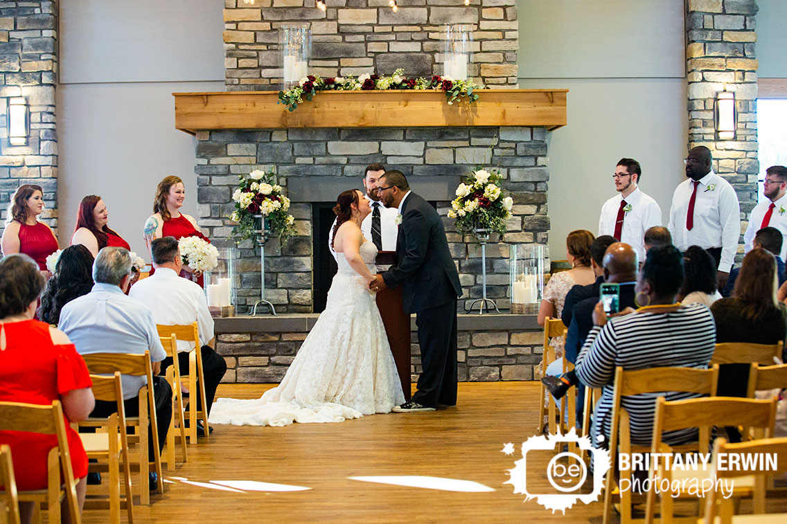 Sycamore-at-Mallow-Run-wedding-photographer-indoor-ceremony-fireplace-first-kiss.jpg