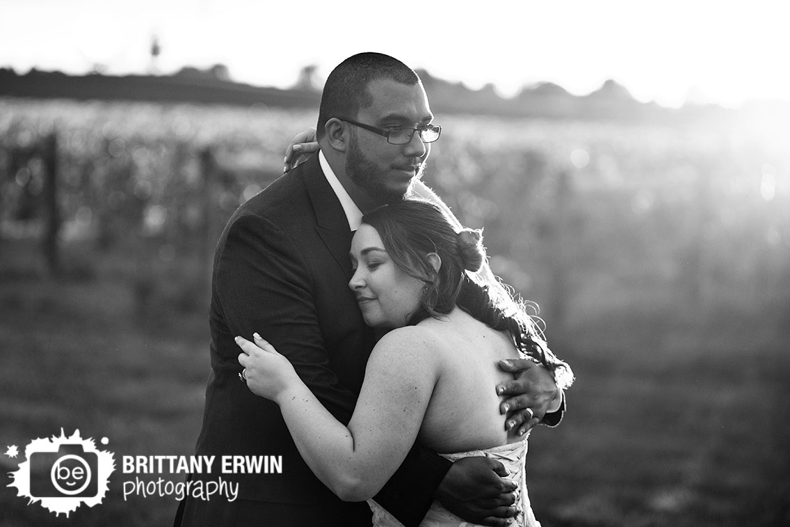 Indianapolis-wedding-portrait-photographer-sunset-vineyard-mallow-run-winery-couple-hug.jpg