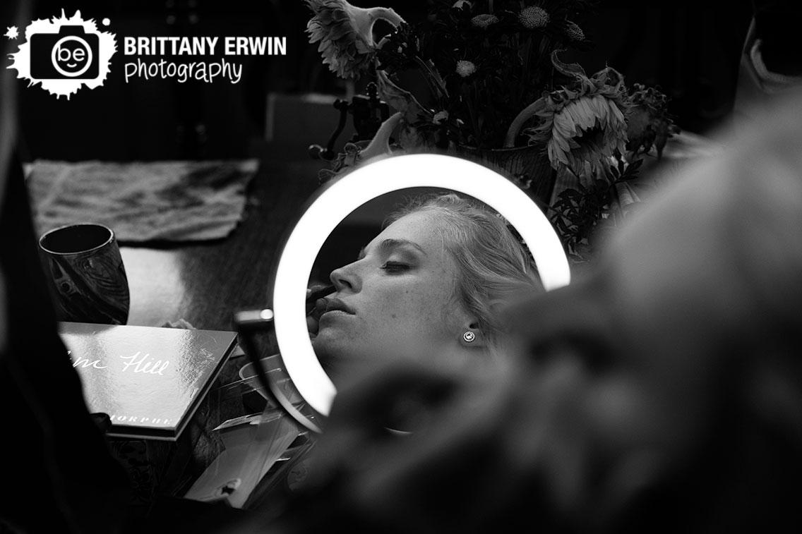 Wedding-photographer-bride-getting-ready-makeup-in-mirror.jpg