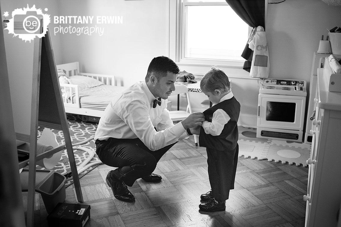 wedding-photographer-groom-helping-son-get-ready-the-black-tux-rental.jpg