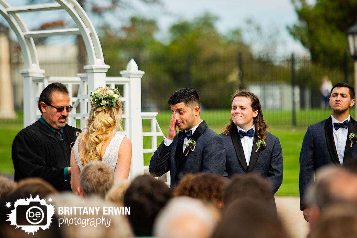 Garfield-Park-wedding-photographer-groom-reaction-wipe-eyes-ceremony.jpg