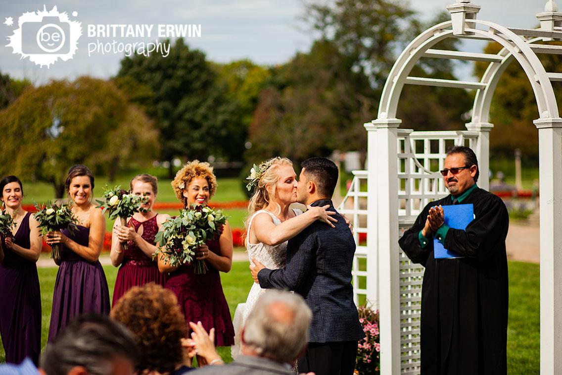 Garfield-Park-sunken-garden-bridesmaids-reaction-first-kiss-husband-wife.jpg