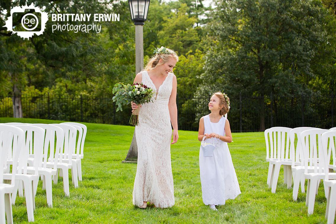 bride-with-flower-girl-portrait-in-aisle-garfield-park-sunken-garden-walking.jpg