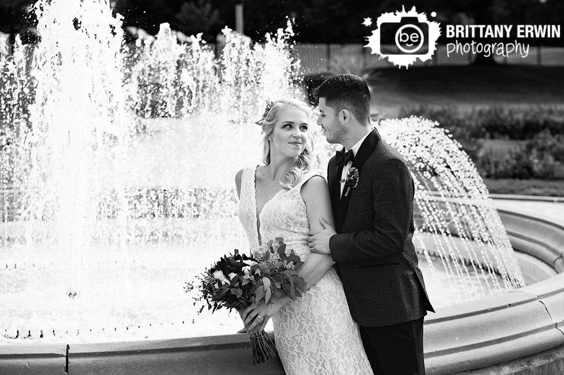 Garfield-Park-conservatory-sunken-gardens-bride-groom-portrait-with-fountain-bridal-couple.jpg