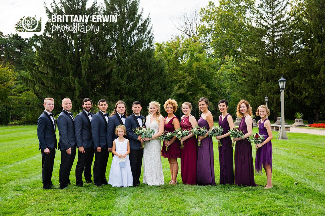 Bridal-party-portrait-Garfield-Park-sunken-gardens-green-field-couple-with-bridesmaids-and-groomsmen.jpg