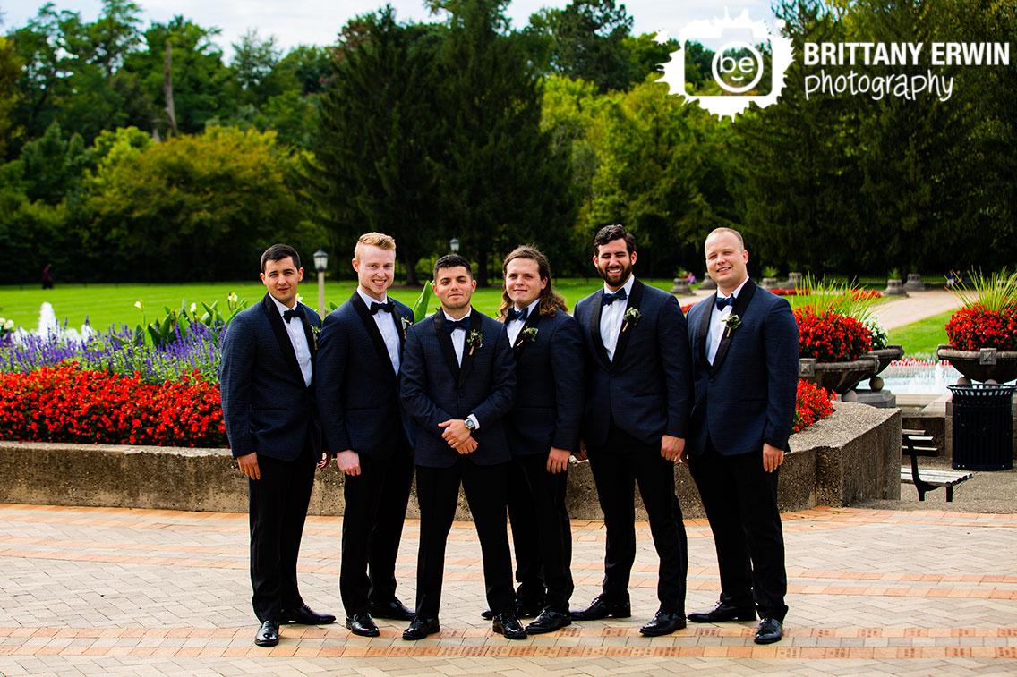 Garfield-Park-Sunken-Gardens-groomsmen-portrait-flowers-outsdie-fall-wedding-photographer.jpg