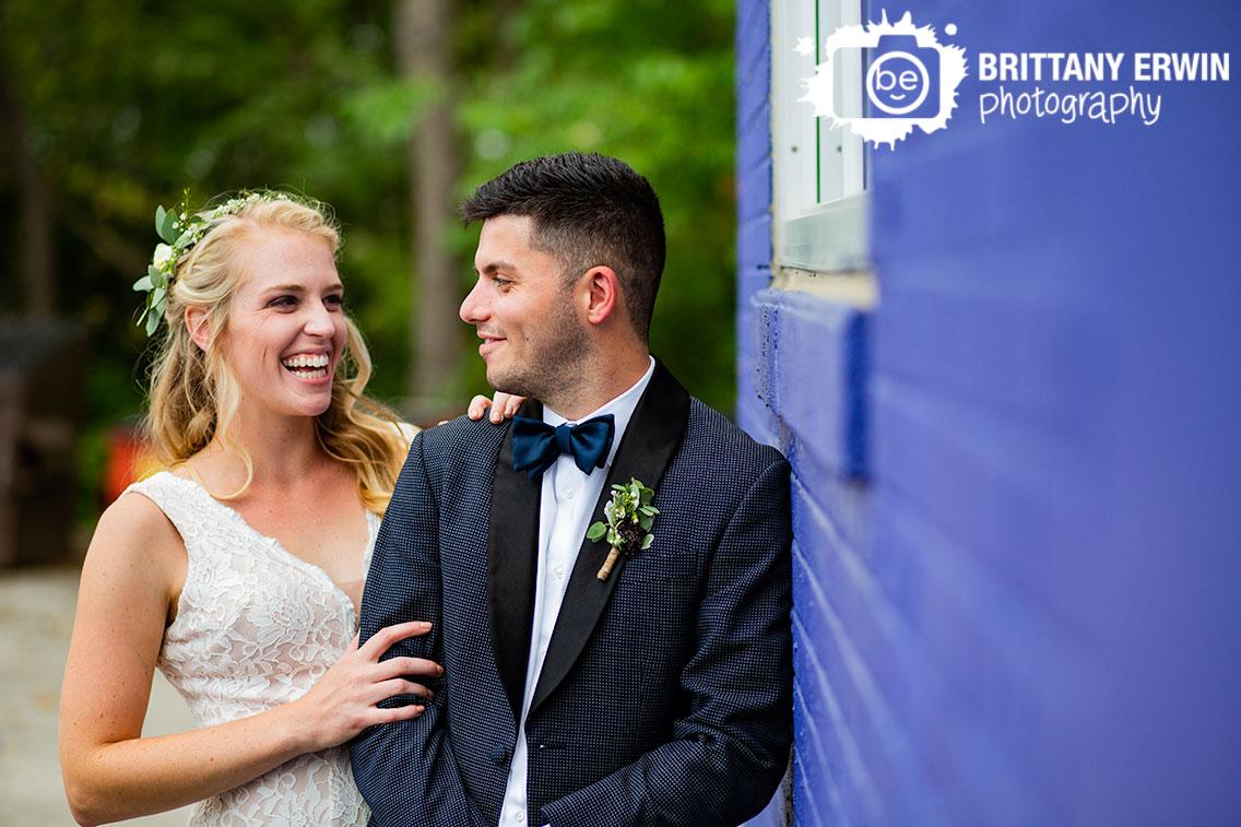 Fountain-Square-indiana-wedding-photographer-purple-brick-wall-couple-black-tux-floral-crown-bowtie.jpg